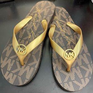 Michael Kors Flip-Flops. Size 8. NEVER WORN.